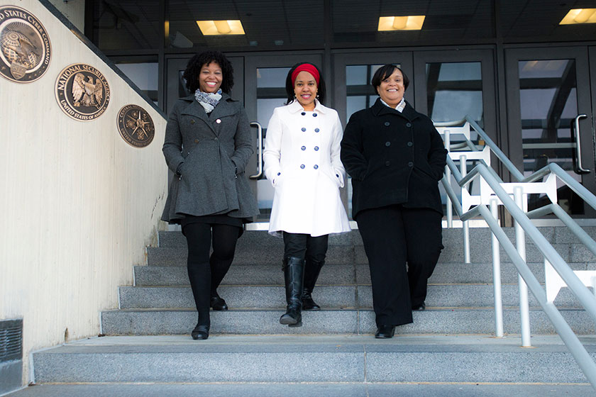 (L to R) Portrait of Dr. Aziza Jefferson, Dr. Valerie Nelson, and Dr. Philicity Williams stepping down stairs in unison in front of NSA's Fort Meade Headquarters