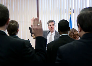 Picture of Deputy Director  NSA John C. Inglis  raising right hand to lead oath.