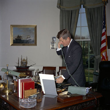 President Kennedy on phone in Oval Office