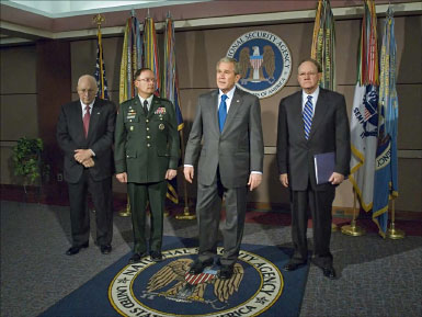 President George W. Bush, Vice President Dick Cheney, NSA Director Lieutenant General Keith B. Alexander, USA, and Director of National Intelligence Michael McConnell during President Bush's visit to NSA in 2008