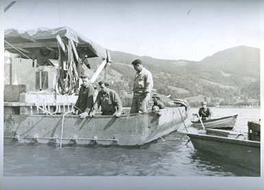 U.S. and U.K. Army Engineers conduct diving operations to recover Nazi cryptologic records sunk in a lake in Bavaria, Germany at the end of World War II